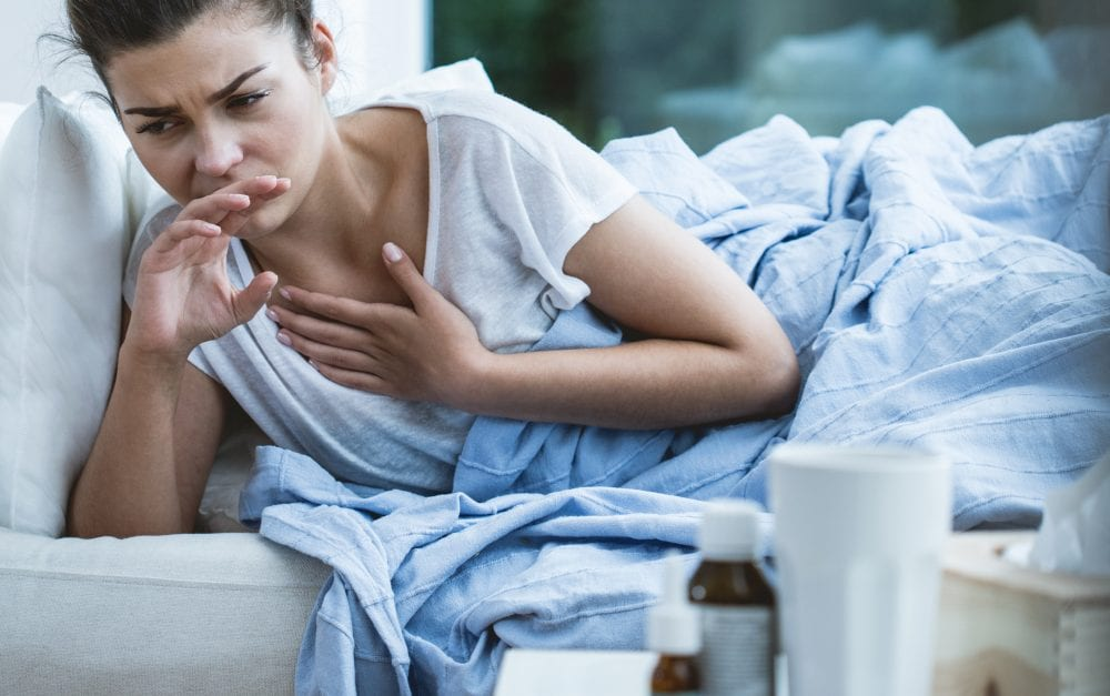 Picture of sick woman with cough and throat infection
