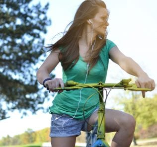 young woman with bicycle outdoors