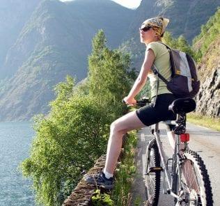 active woman on bike is having break