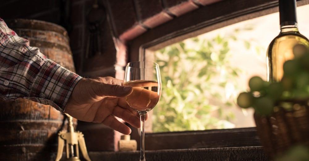 Wine expert tasting a glass of wine