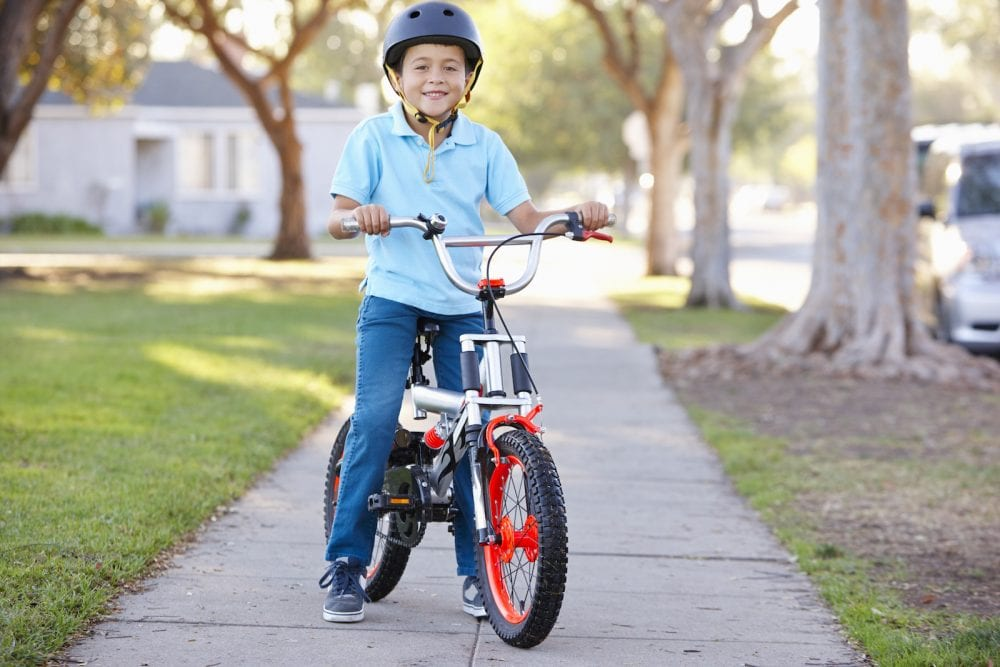 Boy Wearing Safety Helmet Riding Bike