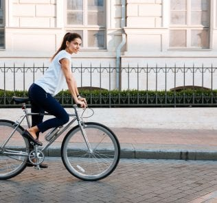 Portrait of a pretty woman on bicycle in the city